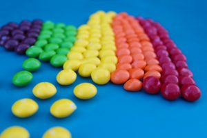 assorted colored skittles lined up