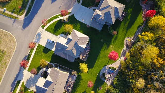 birds eye view of 3 houses