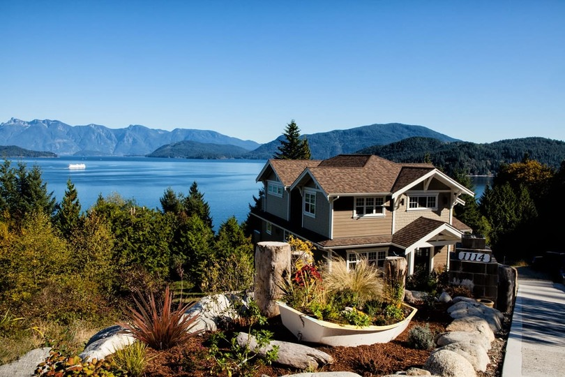 luxury house with a lake in the background