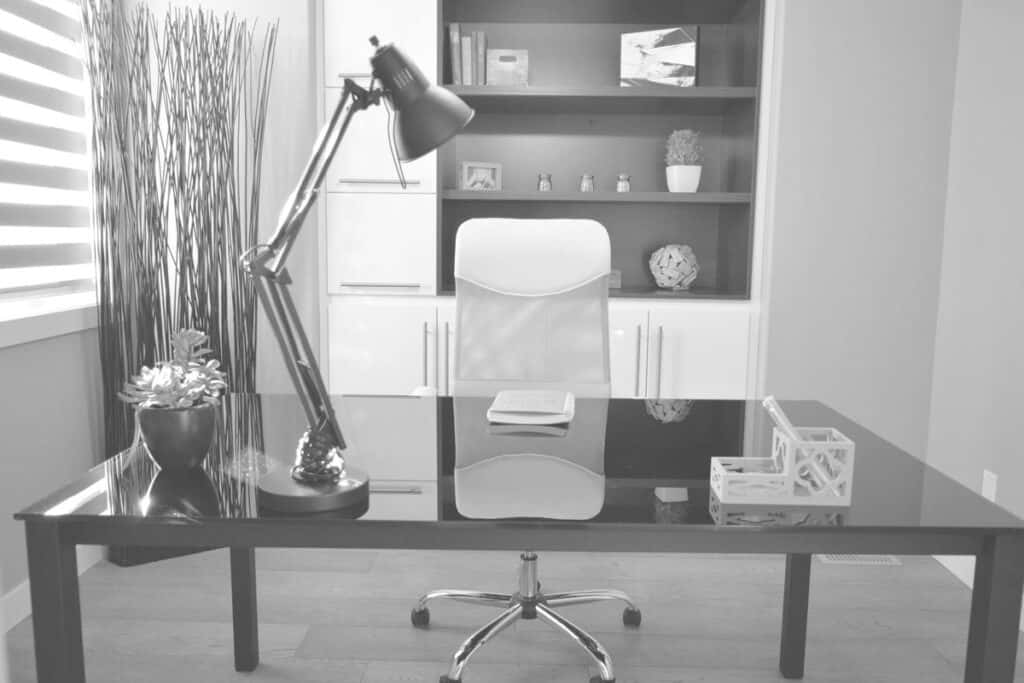 black and white desk with a computer
